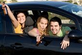 stock photo of underage  - drink and drive underage kids drinking alcohol and partying in car - JPG