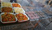 Trays With Onions And Peppers Next To The Grills With The Burgers At A Barbecue poster