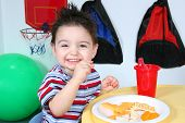 Adorable Preschooler Eating Snacks poster