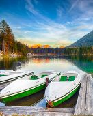 Fantastic Autumn Evening At Hintersee Lake. Few Boats On The Lake With Turquoise Water Of Hintersee  poster