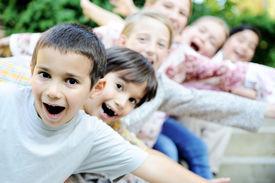 stock photo of children group  - happy children together outdoor - JPG