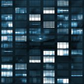 stock photo of voyeur  - Voyeuring Office Building After Dark In Blue Tones - JPG