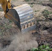 picture of dredge  - An hydraulic  excavator on a construction site during construction work  Excavation and dredging  - JPG