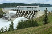 stock photo of hydroelectric  - The spillway with high water at Ghost Hydroelectric Dam Alberta Canada - JPG