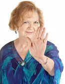 picture of cynicism  - Senior European woman in blue with hand up - JPG