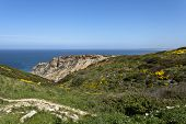 stock photo of promontory  - Cape Espichel is a historic place and mark near Sesimbra in Portugal name as barbaric Promontory by the Romans - JPG
