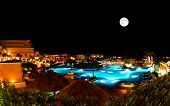 stock photo of all-inclusive  - a luxury all inclusive beach resort at night in Cancun Mexico