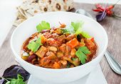 pic of pinto bean  - Vegetarian chilli with red and white beans close up selective focus - JPG