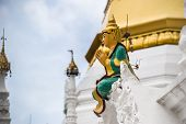 stock photo of yangon  - Statue of a man preying in the Shwedagon paya Yangon myanmar - JPG