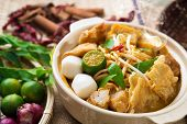 stock photo of malaysian food  - Hot and spicy Malaysia Curry Noodle or laksa  mee with hot steam in clay pot - JPG