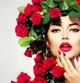 pic of bunch roses  - Beauty Fashion Model Girl Portrait with Red Roses Hairstyle - JPG