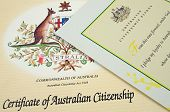 image of citizenship  - close up of a australian citizenship certificate and oath pledge - JPG