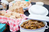 foto of braai  - Fresh roasted bread and mutton kebabs in dishes on a table - JPG