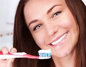 Closeup portrait of beautiful female clean teeth in bathroom, health lifestyle, dental care, teeth w