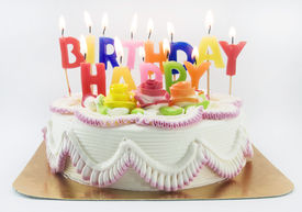 stock photo of happy birthday  - a birthday cake and candle on white - JPG