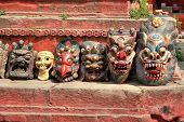 stock photo of nepali  - Traditional Nepali masks on Durbar Square in Kathmandu - JPG