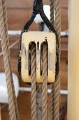 image of pulley  - photograph of a nautical wood pulley two strings - JPG