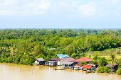 stock photo of rainy season  - Wooden house on the river bank rainy season - JPG