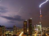 foto of lightning-rod  - Lightning striking the CN Tower in Toronto during a summer thunderstorm - JPG