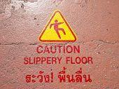 pic of slip hazard  - warning sign in thai and english language at floor in golden mountain wat sraket Bangkok Thailand - JPG