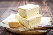foto of margarine  - Fresh butter on a chopping board with knife - JPG