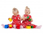 picture of identical twin girls  - children and twins concept  - JPG