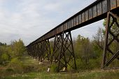 pic of ravines  - A railroad bridge crossing a wooded ravine - JPG