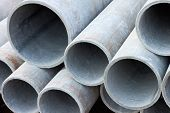 stock photo of asbestos  - Warehouse of pipes of the concrete asbestos - JPG