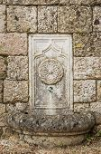 stock photo of filerimos  - Fountain in the Wall of the Castle on the Filerimos Hill in Rhodes - JPG