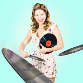 pic of jukebox  - Retro portrait of a beautiful DJ pinup girl with beauty hairstyle and makeup playing a mix of jukebox songs when spinning recorded music discs at nightclub disco - JPG
