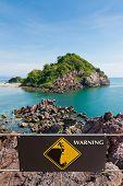 picture of landslide  - Warning sign at beauty Island on summer  - JPG