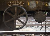 pic of train-wheel  - Brake wheel on old rusty train wagon on Nanu Oya train station in Sri Lanka - JPG