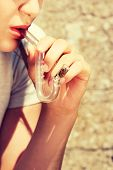 pic of teen smoking  - Teen Girl smoking cannabis outdoor - JPG