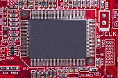 stock photo of informatics  - Red electronic circuit board with processor component - JPG
