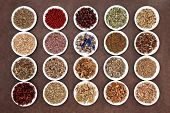 stock photo of wiccan  - Medicinal and naturopathic herb selection also used in witches magical potions over brown lokta paper background - JPG
