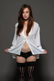 foto of panty-hose  - Pretty pale redhead in a white blouse and black panties - JPG