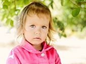 picture of windy weather  - a toddler girl outdoors in windy weather - JPG