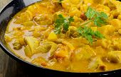 foto of curry chicken  - Chicken curry in bowl on wooden table - JPG