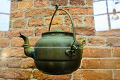 image of kettling  - The old kettle. Old retro kettle. Green tea-water is a beautiful decorative look. This old kettle.