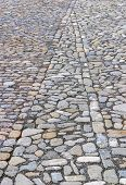 picture of paving stone  - Cobbled or stone paved road creating a geometric pattern from the stones - JPG