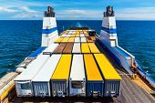 image of container ship  - Cargo ferry commercial industrial ship with truck freight containers in the sea - JPG