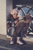 picture of beret  - Little girl in a pink beret holds a toy bear toning - JPG