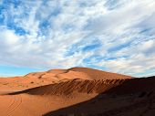 image of saharan  - The steep eroding slopes of the Erg Chebbi Saharan desert of Morocco in winter - JPG