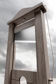stock photo of beheaded  - 3d rendering of a guillotine a dead instrument - JPG