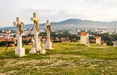 image of calvary  - Jesus Christ Cross on Calvary with City of Nitra and Zobor Mountain in Background - JPG