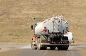 foto of tank truck  - Large tank truck working at a construction site - JPG