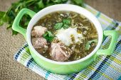 stock photo of sorrel  - sorrel soup with meat and sour cream in a dish - JPG
