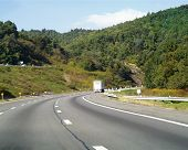 image of 18 wheeler  - transport truck on highway curve - JPG