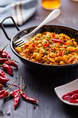 image of curry chicken  - indian chicken curry with peas and chili pepper on pan - JPG