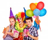 picture of clowns  - Birthday party group of teen people with female clown taking balloons  - JPG